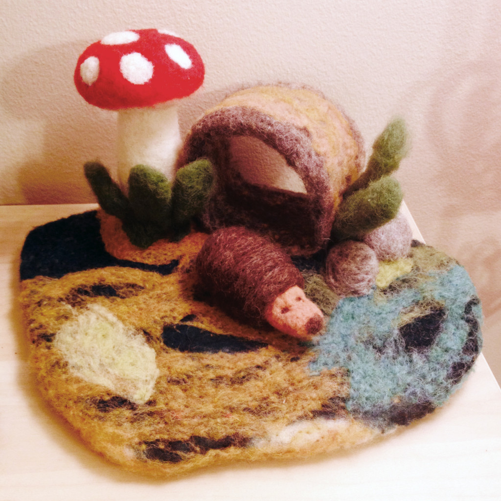 Needle felted play mat with a hedgehog