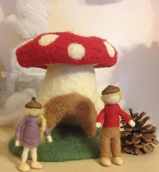 Waldorf-inspired toadstool with dolls