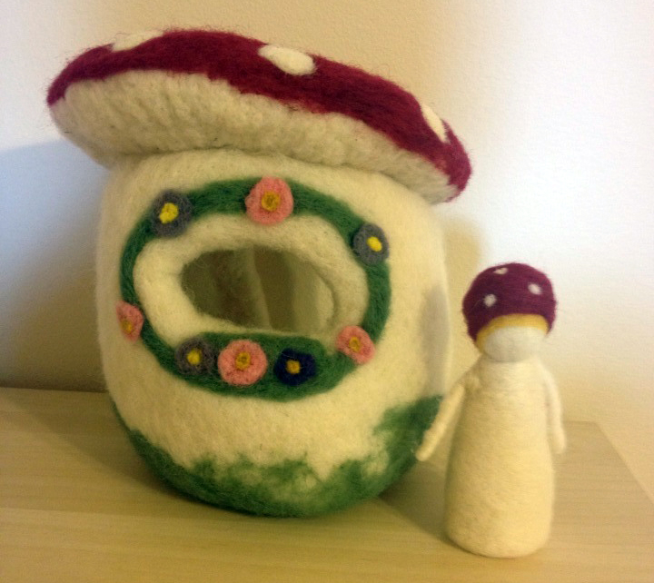 Needle felted toadstool house with a toadstool child